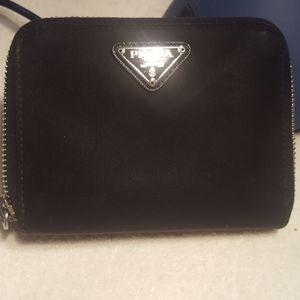 Prada Authentic zip around Tessuto wallet.